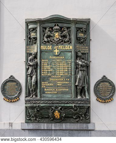 Gent, Flanders, Belgium - July 30, 2021: Gold On Green Bronze Fresco Againt White Wall Of House In G