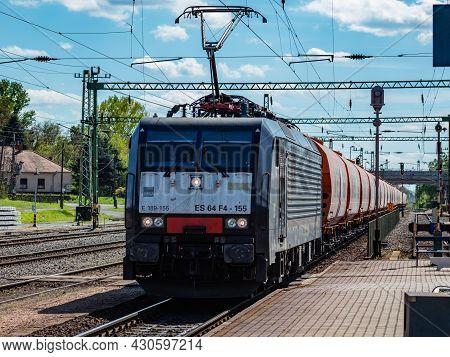 Balatonszentgyorgy, Hungary - May 8, 2021: International Train Transportation. Cargo Freight Train W