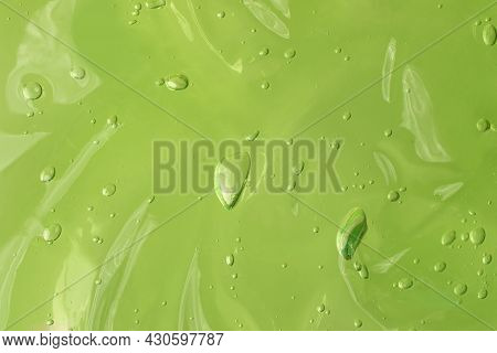 Jelly Waved Serum With Bubbles On The Green Background.cosmetics Smear Of Aloe Vera Or Antibacterial