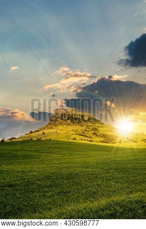 Castle On The Hill Beneath A Rainbow At Sunset. Composite Fantasy Landscape. Grassy Meadow In The Fo