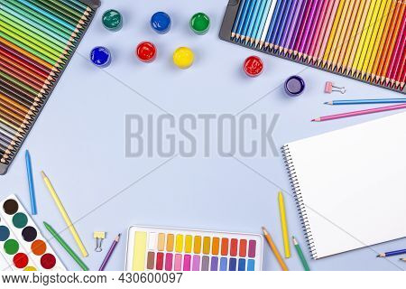 Creative Art Work Supplies Background. Watercolor, Brushes, Pencils, Notebook On Light Gray Table. T