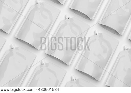 White Plastic Pouch Bags With A Corner Lid Arranged In A Row, Mock-up Template For Design. 3d Render