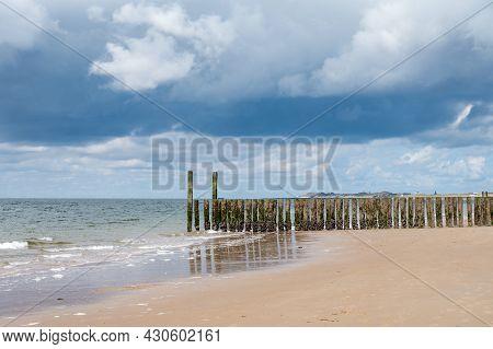 Walking On White Sandy North Sea Beach Near Zoutelande, Zeeland, Netherlands Before Thunderstorm