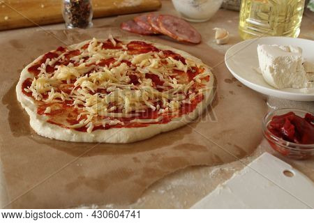 Step-by-step Instructions For Cooking Pizza. Step 2. On The Basis For Pizza With Sauce Put Grated Ch