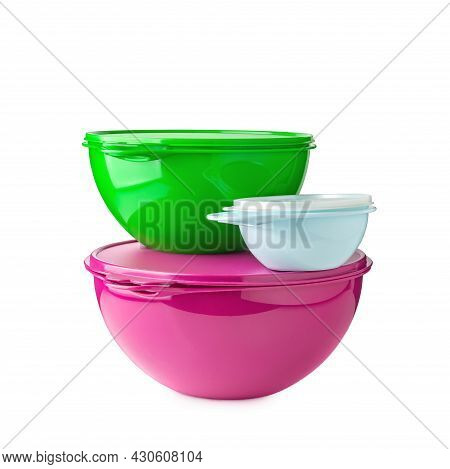 Stack Of Plastic Containers. Plastic Bowls Of Green, Pink And Blue Colors On A White Background. Foo
