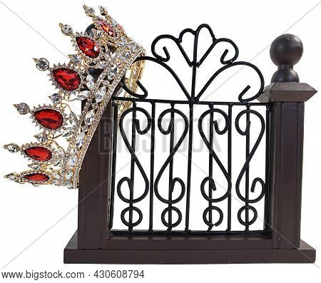 Golden Jeweled Crown On A Fancy Gate