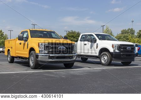 Indianapolis - Circa August 2021: Ford F-350 And F-250 Display At A Dealership. Ford F-series Pickup