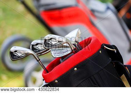 Minsk. Belarus - 18.07.2021 - Silver Golf Clubs In The Bag On The Field.