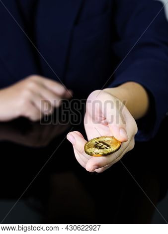 Close Up Of Businesswoman Holding Some Pieces Of Golden Bitcoin Token