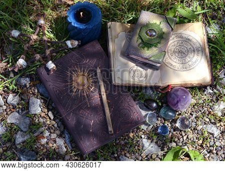 Still Life With Witch Manuscripts And Book, Crystal And Candles In The Garden. Esoteric, Gothic And
