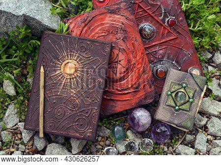 Three Magic Book Of Spells And Witch Diary Witch Crystals In The Garden.  Esoteric, Gothic And Occul