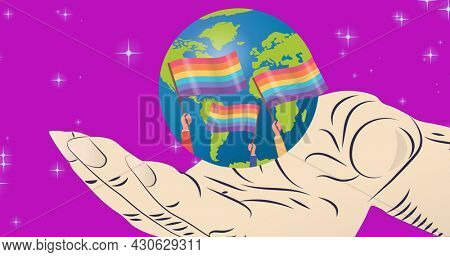 Hand holding globe with lgbtq flags over purple background. lgbtq pride and equality celebration concept digitally generated .