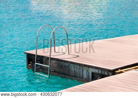 Floating Dock With Composite Deck And Ladder At The Marina.