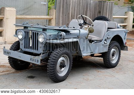 Bordeaux , Aquitaine  France - 08 17 2021 : Jeep Willys 4x4 Car From Second World War Two In Navy Co