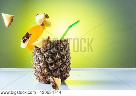 Flying Pineapple Slices. Pineapple Slices In The Air. Pineapple Cocktail And Flying Slices.