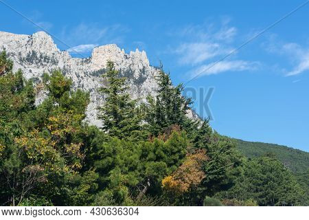 Ai-petri Crimea Teeth On The Background Of The Blue Sky. Majestic View Of The Dense Forest On The Mo
