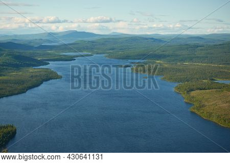 Aeriel View To Kiruna Wilderness From Helicopter With Large Lake  In The Middle Of The Forest In Far