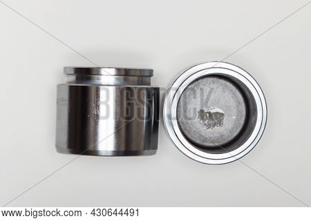 Two Metal Cylindrical Pistons, Machine Repair Parts. A Set Of Spare Parts For Servicing The Braking