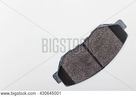 One Brake Pad, New Parts For Car Repair. A Set Of Spare Parts For Servicing The Braking System Of A