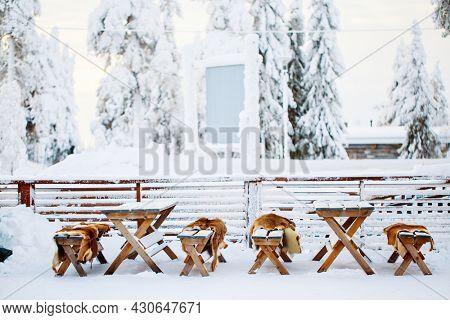 Wooden tables in outdoor restaurant in Lapland Finland