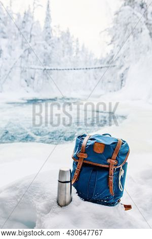 Winter picnic by river in snow covered forest in Oulanka National Park in Lapland Finland