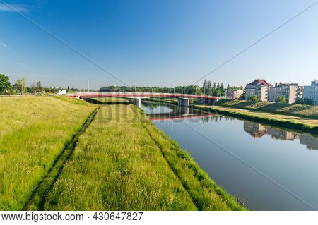 Opole, Poland - June 4, 2021: Nice View On Ulgi Canal With Bridge. Ulgi Canal Is Flow Canal Of The O