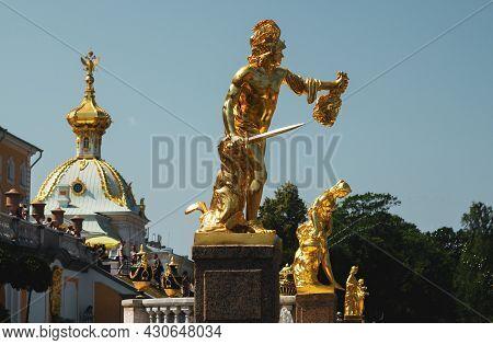 Saint Petersburg, Russia, July 2021: Golden Statue Of Perseus In Peterhof.