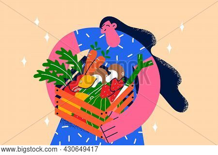 Healthy Clean Eating And Fresh Diet Concept. Young Smiling Female Standing Holding Basket Of Fresh P