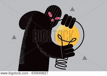 Plagiarism And Thieving Ideas Concept. Young Fraud Thief In Black Mask And Clothes Standing Holding