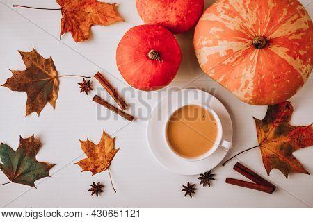 Pumpkin Smoothie, Spice Latte. Boozy Cocktail With Cinnamon Sticks Anise Stars. Maple Leaves Decorat