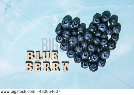 Heart Made Of Fresh Blueberries And Blueberry Text. Blueberry Antioxidant Organic Superfood Concept