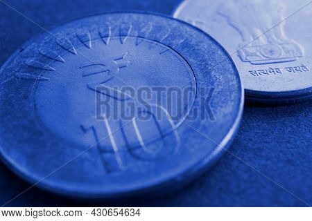 Translation: Truth Alone Triumphs. Two Indian Coins Lie On Textured Surface. 10 Rupee Coin With The