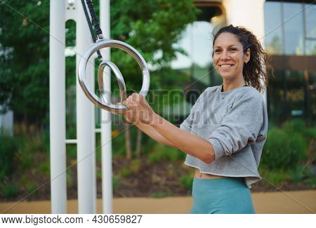 Mid Adult Woman Doing Exercise Outdoors In City Workout Park, Healthy Lifestyle Concept.