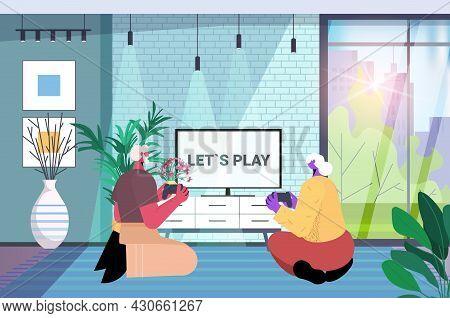 Senior Couple Having Fun Grandparents Playing Video Games Mature Man Woman Using Wireless Gamepads C