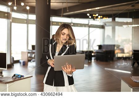 Confident Businesswoman Ceo Female Checking Emails Online, Doing Job On Laptop While Walking On Offi