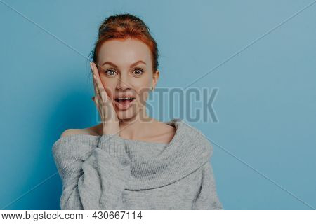 Portrait Of Surprised Amazed Red Haired Woman Looking At Camera With Impressed Face Expression, Feel