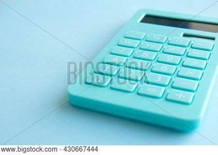 Mint Calculator, Notebook And Pen On Blue Background