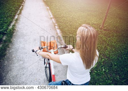 Back View Of A Woman In White T-shirt With A City Bicycle.