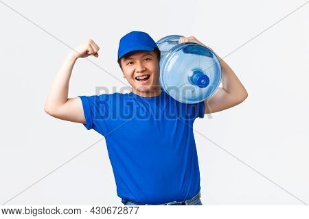 Office And Home Delivery And Employees Concept. Upbeat Smiling Asian Courier In Blue Uniform, Flex B