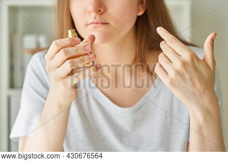 Portrait Of Caucasian Faceless Young Woman Inhaling Aroma Of Perfume Bottle, Loosing Sense Of Smell