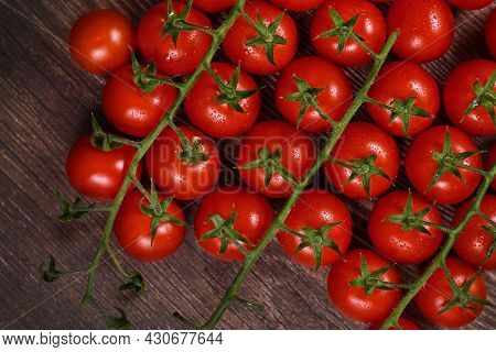 Top View Of Trusses Of Small  Ripe Cherry Tomatoes