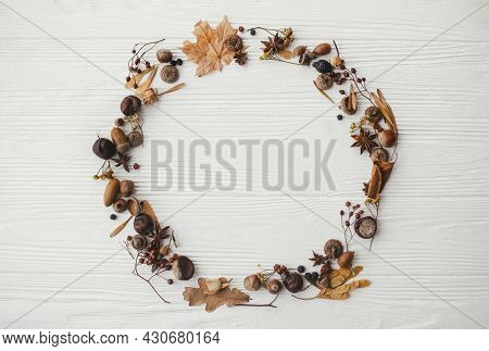 Autumn Wreath Flat Lay. Autumn Leaves, Berries, Nuts, Anise, Acorns In Circle On White Wood, Autumna