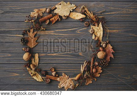 Autumn Wreath Flat Lay. Autumn Leaves, Berries, Nuts, Anise, Acorns In Circle On Dark Wood. Rustic A