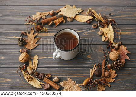 Hello Autumn. Cup Of Tea In Autumn Wreath. Autumn Leaves, Berries, Nuts, Anise, Acorns In Circle Wit