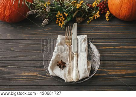 Modern Plate With Vintage Cutlery, Linen Napkin, Anise On Wooden Table With Pumpkins And Autumn Flow
