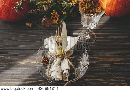 Thanksgiving Dinner Table Setting. Modern Plate With Vintage Cutlery, Linen Napkin, Herb And Glass O