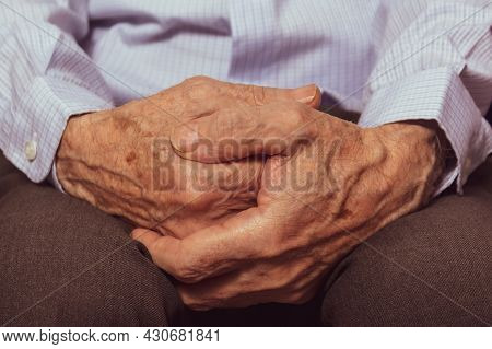 Unrecognizable Caucasian Very Old Mans Hands. Close-up. Grandfathers Hands In Blue Shirt. The Hard L