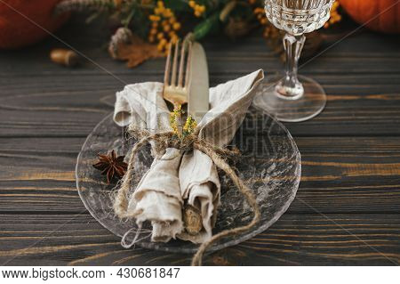 Thanksgiving Dinner Rustic Table Setting. Modern Plate With Vintage Cutlery, Linen Napkin, Herb And
