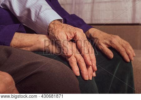 Elderly Husband Holds Wifes Hand. Care Concept. Unrecognizable Caucasian Grandfather And Grandmother