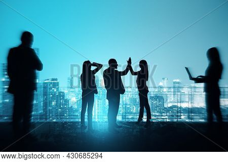 Group Of Businesspeople With Hi-five Gesture Standing On Night City Sky With Mock Up Place Backgroun